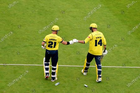 D'Arcy Short and James Vince of Hampshire Hawks walk out  to open the batting during the Vitality T20 Blast match between Gloucestershire and Hampshire Hawks at The Bristol County Ground, Bristol