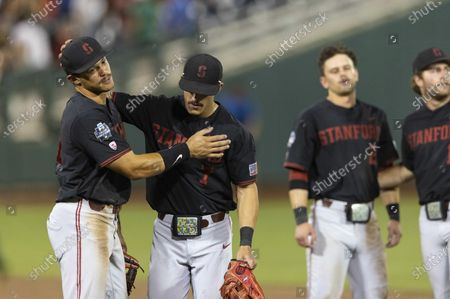 Stanford's Christian Robinson (44), left, and Brock Jones (7) react to their 6-5 loss to Vanderbilt during a baseball game in the College World Series, at TD Ameritrade Park in Omaha, Neb