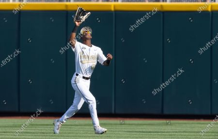 Vanderbilt's Enrique Bradfield Jr. (51) catches a fly ball to center field hit by Stanford's Christian Robinson in the first inning during a baseball game in the College World Series, at TD Ameritrade Park in Omaha, Neb