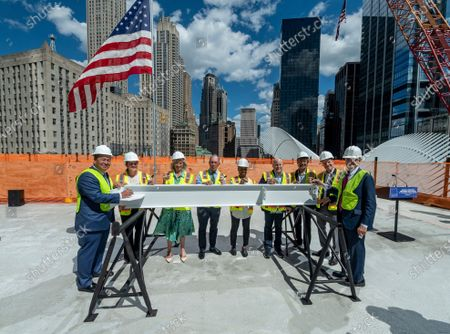 Stock Picture of From left to right, Kevin O'Toole, Chairman, Port Authority of New York and New Jersey; Holly Leicht, Chair of the Board, Lower Manhattan Development Corporation; Leslie Koch, President, Ronald O. Perelman Performing Arts Center (PAC); Michael R. Bloomberg, Chair of the Board, PAC, and 108th mayor of New York City; Jawole Willa Jo Zollar, dancer and choreographer, PAC Artistic Advisor; Ronald O. Perelman, Chairman and CEO, MacAndrews & Forbes; David Henry Hwang, playwright, PAC Artistic Advisor; Bill Rauch, PAC Artistic Director; and Rick Cotton, Executive Director, Port Authority of New York and New Jersey, sign the final beam at the topping off ceremony for the Ronald O. Perelman Performing Arts Center at the World Trade Center, in New York