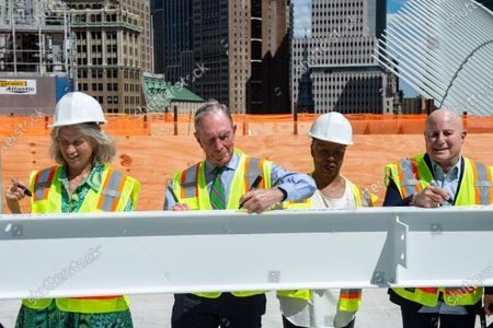 Leslie Koch, President, Ronald O. Perelman Performing Arts Center (PAC); Michael R. Bloomberg, Chair of the Board, PAC, and 108th mayor of New York City; Jawole Willa Jo Zollar, dancer and choreographer, PAC Artistic Advisor; and Ronald O. Perelman, Chairman and CEO, MacAndrews & Forbes, from left to right, sign the final beam at the topping off ceremony at the Ronald O. Perelman Performing Arts Center at the World Trade Center, in New York