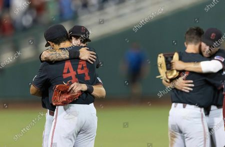 Stanford's Brock Jones hugs Christian Robinson (44) following their 6-5 loss to Vanderbilt during a baseball game in the College World Series, at TD Ameritrade Park in Omaha, Neb