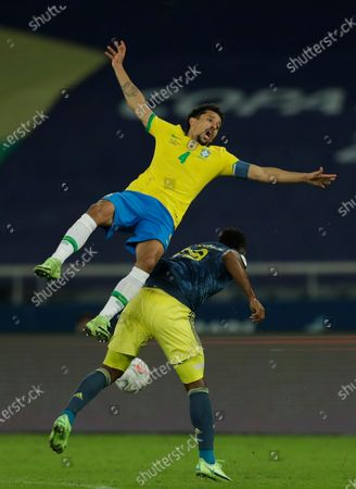 Brazil's Marquinhos, left, and Colombia's Miguel Borja battle for the ball during a Copa America soccer match at Nilton Santos stadium in Rio de Janeiro, Brazil