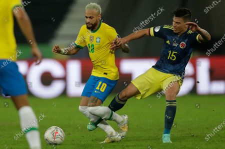 Stock Picture of Brazil's Neymar, left, and Colombia's Mateus Uribe battle for the ball during a Copa America soccer match at Nilton Santos stadium in Rio de Janeiro, Brazil