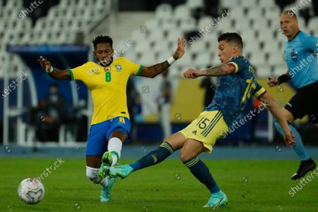 Stock Image of Brazil's Fred, left, and Colombia's Mateus Uribe battle for the ball during a Copa America soccer match at Nilton Santos stadium in Rio de Janeiro, Brazil