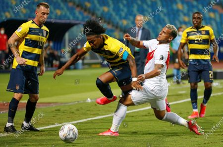 Ecuador's Angelo Preciado (C-L) in action against Peru's Miguel Trauco (C-R) during the Copa America 2021 group B soccer match between Ecuador and Peru at the Pedro Ludovico Teixeira Olympic Stadium in Goiania, Brazil, 23 June 2021.