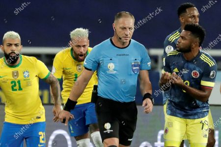 Colombia's Miguel Borja (R) argues with Argentine referee Nestor Pitana (C), during the Copa America 2021 group B soccer match between Brazil and Colombia at the Nilton Santos Olympic Stadium in Rio de Janeiro, Brazil, 23 June 2021.