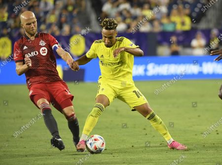 Nashville SC midfielder Hany Mukhtar (10) and Toronto FC midfielder Michael Bradley (4) fight for the ball during the second half of an MLS game between Toronto CF and the Nashville SC at Nissan Stadium in Nashville TN Steve Roberts/CSM
