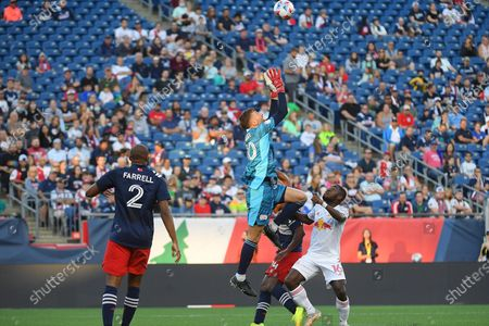 Stock Picture of New England Revolution goalkeeper Matt Turner (30) makes a save during the MLS game between New York Red Bulls and the New England Revolution held at Gillette Stadium in Foxborough Massachusetts. New England defeats New York 3-2