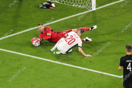 (210624) - MUNICH, June 24, 2021 (Xinhua) - Goalkeeper Manuel Neuer (L) of Germany makes a save during the UEFA Euro 2020 Championship Group F match between Germany and Hungary in Munich, Germany, June 23, 2021.