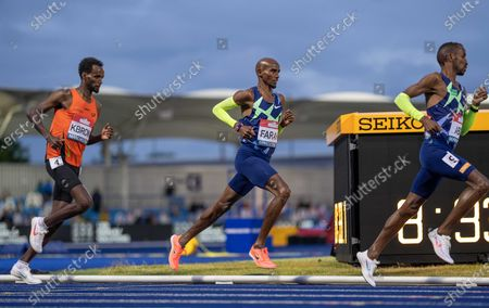 Mo Farah fails to qualify for Tokyo, here led by pacer and teammate Bashir Abdi; Manchester Regional Arena, Manchester, Lancashire, England; Muller British Athletics Championships.