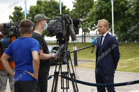Stock Image of Joel Pohjanpalo of Team Finland talks to the press as the team arrives from UEFA Euro 2020 football tournament to the Helsinki-Vantaa airport in Vantaa, Finland on June 24, 2021.
