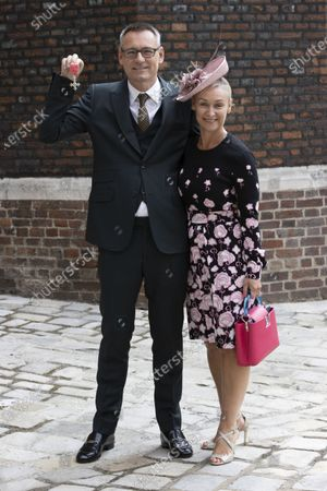 Stock Picture of Jason Iley and his wife Nadia, with his MBE, for services to music and charity, after an Investiture at St. James Palace in London.