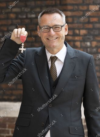 Jason Iley with his MBE, for services to music and charity, after an Investiture at St. James Palace in London.
