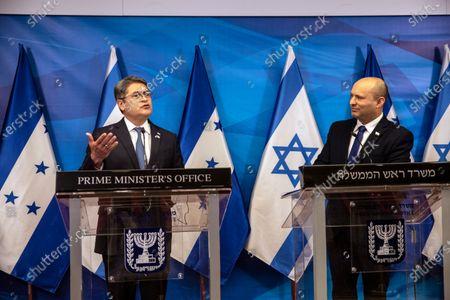 Israeli Prime Minister Naftali Bennett, right, and Honduran President Juan Orlando Hernandez, give statements at the prime minister's office, in Jerusalem