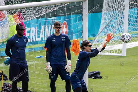 Switzerland's goalkeepers (L-R) Yvon Mvogo, Gregor Kobel, and Yann Sommer perform during their team's training session at the Tre Fontane sports centre in Rome, Italy, 24 June 2021. Switzerland will face France in their UEFA EURO 2020 round of 16 soccer match on 28 June 2021 in Bucharest, Romania.