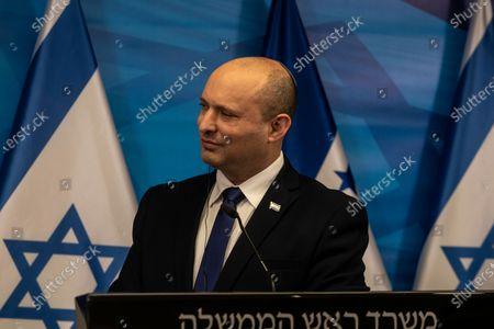Israeli Prime Minister Naftali Bennett listens to Honduran President Juan Orlando Hernandez (unseen), during a press conference at the Prime Minister's Office in Jerusalem, Israel, 24 June 2021.