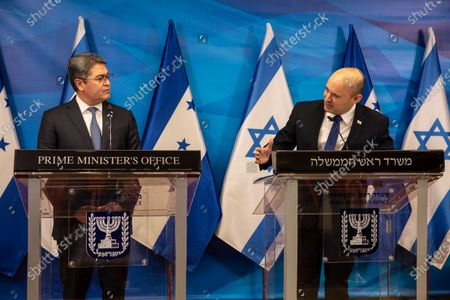 Israeli Prime Minister Naftali Bennett (R) and  Honduran President Juan Orlando Hernandez (L) give statements during a press conference at the Prime Minister's Office in Jerusalem, Israel, 24 June 2021.