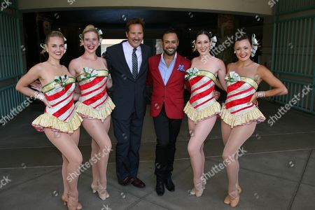 """Stock Image of Cary Berglund (center left), master News Reporter from Channel 4 (KNBC),  Nick Verreos (center right), FIDM Grad/Instructor and """"Project Runway"""" Star with  Radio City Music Hall Rockettes(L to R): Katie Russell, Laura Danelski, Alyssa Epstein and Traci Reszetylo in the """"12 Days of Christmas"""" costume"""