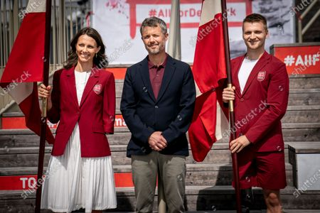 Crown Prince Frederik of Denmark (C) presents flags to the two Paralympics flag bearers Lisa Gjessing (L) and Daniel Wagner (R) in connection with DIF and Team Denmark  announcing the Danish flag bearers for the Olympic and Paralympic Games in Tokyo at a press conference in Experimentarium in Hellerup, Denmark, 24 June 2021.