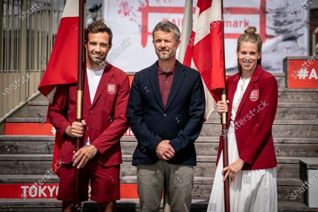 Crown Prince Frederik of Denmark (C) presents flags to the two flag bearers Sara Slott Petersen (R) and Jonas Warrer (L) in connection with DIF and Team Denmark  announcing the Danish flag bearers for the Olympic and Paralympic Games in Tokyo at a press conference in Experimentarium in Hellerup, Denmark, 24 June 2021.
