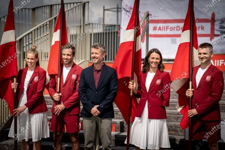 Crown Prince Frederik of Denmark (C) presents flags to the two Olympic flag bearers Sara Slott Petersen (L) and Jonas Warrer (2-L) as well as the two Paralympics flag bearers Lisa Gjessing (2-R) and Daniel Wagner (R) in connection with DIF and Team Denmark announcing the Danish flag bearers for the Olympic and Paralympic Games in Tokyo at a press conference in Experimentarium in Hellerup, Denmark, 24 June 2021.