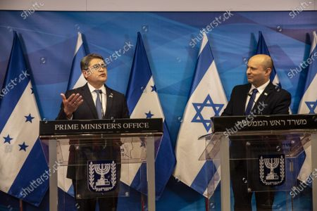 Israeli Prime Minister Naftali Bennett (R) and Honduran President Juan Orlando Hernandez give statements at the Prime Minister's Office in Jerusalem, Israel, on Thursday, June 24, 2021.
