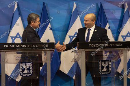 Israeli Prime Minister Naftali Bennett (R) and Honduran President Juan Orlando Hernandez shake hands after making statements at the Prime Minister's Office in Jerusalem, Israel, on Thursday, June 24, 2021.