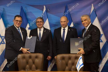 Israeli Prime Minister Naftali Bennett (C), Honduran President Juan Orlando Hernandez (2nd L), Israeli Foreign Minister Yair Lapid (R) and Honduran Foreign Minister Lisandro (L) hold documents after signing agreements at the Prime Minister's Office  in Jerusalem, Israel, on Thursday, June 24, 2021.