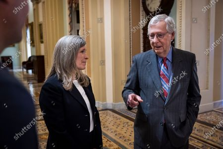 Republican Senate Minority Leader Mitch McConnell (R) chats with Republican Senator from Iowa Joni Ernst (L) inside the US Capitol in Washington, DC, USA, 24 June 2021. The bipartisan group of 10 senators negotiating the transportation bill reportedly have a deal, and will present their package to US President Joe Biden.