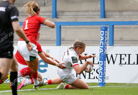 Eleri Michael of Wales touches down in the 2nd half despite the attention of Shaunni Davies of Wales and Kathryn Salter of Wales