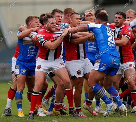 Bodene Thompson of Leeds Rhinos gets a red for fighting in the 1st half. also in pix is Joe Burgess of Salford Red Devils