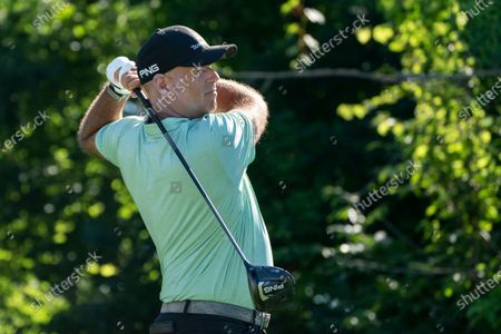 Stewart Cink watches his shot on the 13th tee during the first round of the Travelers Championship golf tournament at TPC River Highlands, in Cromwell, Conn
