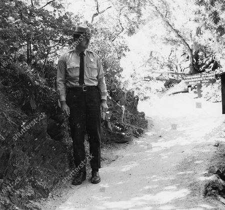 In this photo provided by the National Park Service Timpanogos Cave National Monument Ranger Jay Allen is shown in 1968, the year he started leading tours shortly after college graduation. He has retired after more than 50 years guiding thousands of tourists