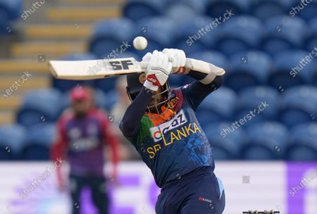 Sri Lanka's Kusal Mendis attempts to play a ball bowled by England's Mark Wood during the second T20 international cricket match between England and Sri Lanka in Cardiff, Wales