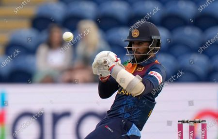 Sri Lanka's Kusal Mendis avoids a short ball from England's Mark Wood during the second T20 international cricket match between England and Sri Lanka in Cardiff, Wales