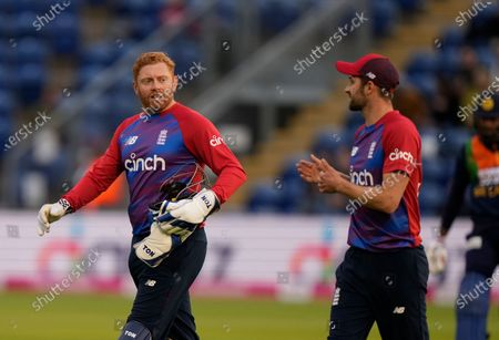 England's Jonny Bairstow left talks to England's Mark Wood during the second T20 international cricket match between England and Sri Lanka in Cardiff, Wales
