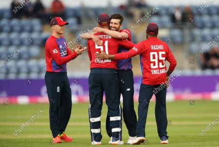 Mark Wood of England celebrates with Jonny Bairstow of England after taking the wicket of Kusal Mendis of Sri Lanka