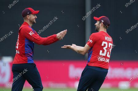 Liam Livingstone of England celebrates with Mark Wood of England after he catches Avishka Fernando of Sri Lanka