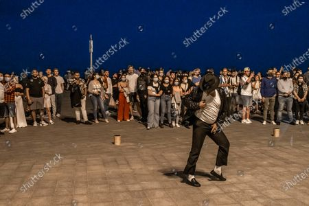 An artist seen during the Summer Solstice Night performing the musical Thriller by Michael Jackson during the Summer Solstice Night. Barcelona celebrates the Summer Solstice Night with its traditional open-air festivals. The public spaces of the beach this year had special security measures to avoid crowds and protect the rest of the night for residents of the Barceloneta neighborhood, close to the beaches.