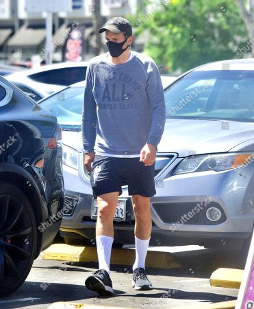 Exclusive - Ashton Kutcher and Mila Kunis were spotted out in Sherman Oaks, as they took their 2 Kids for Ice Cream. The family masked up, despite the lift on masks in LA, as they stepped out of their Tesla SUV. They looked like a normal family as they enjoyed the sweet treats together. Ashton couldn't wait to get a taste of his Ice Cream Cone one he was safely back in the car