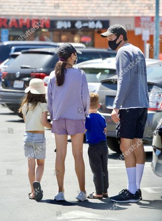 Stock Photo of Exclusive - Ashton Kutcher and Mila Kunis were spotted out in Sherman Oaks, as they took their 2 Kids for Ice Cream. The family masked up, despite the lift on masks in LA, as they stepped out of their Tesla SUV. They looked like a normal family as they enjoyed the sweet treats together. Ashton couldn't wait to get a taste of his Ice Cream Cone one he was safely back in the car