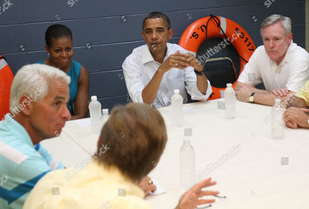 Mayor Scott Clemes, Florida Governor Charlie Christ, United States President Barack Obama, his wife Michelle, and Secretary of the Navy Ray Mabus at a Coast Guard base in Panama City