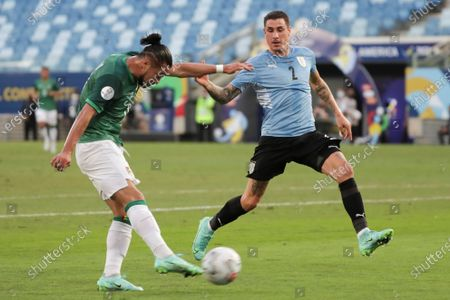 Uruguay's Jose Gimenez in action against Bolivia's Rodrigo Ramallo, during the soccer match for Group A of the Copa America 2021 between Bolivia and Uruguay at the Arena Pantanal stadium in Cuiaba, Brazil, 24 June 2021.