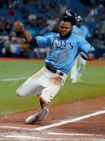 Tampa Bay Rays' Manuel Margot scores on a wild pitch by Boston Red Sox relief pitcher Matt Barnes during the ninth inning of a baseball game, in St. Petersburg, Fla