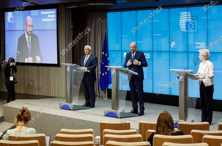 European Council President Charles Michel, center, speaks during a news conference with European Commission President Ursula von der Leyen, right, and Portugal's Prime Minister Antonio Costa at the end of an EU summit at the European Council building in Brussels, . EU leaders discussed the economic challenges the bloc faces due to coronavirus restrictions and will review progress on their banking union and capital markets union