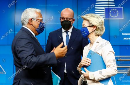 European Commission President Ursula von der Leyen, European Council President Charles Michel and Portugal's Prime Minister Antonio Costa, from right, talk after a news conference at the end of an EU summit at the European Council building in Brussels, . EU leaders discussed the economic challenges the bloc faces due to coronavirus restrictions and will review progress on their banking union and capital markets union