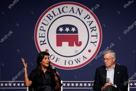 Stock Picture of Former Ambassador to the United Nations Nikki Haley speaks during the Iowa Republican Party's Lincoln Dinner as former U.S. Ambassador to China Terry Branstad, right, looks, in West Des Moines, Iowa