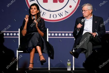Stock Image of Former Ambassador to the United Nations Nikki Haley speaks during the Iowa Republican Party's Lincoln Dinner as former U.S. Ambassador to China Terry Branstad, right, looks, in West Des Moines, Iowa