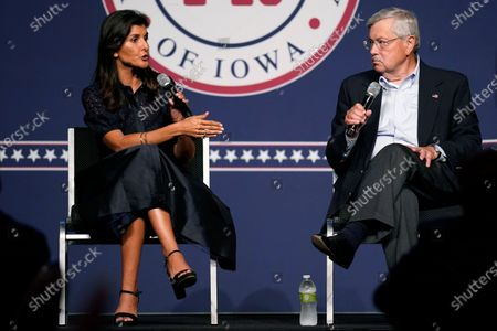 Former Ambassador to the United Nations Nikki Haley speaks during the Iowa Republican Party's Lincoln Dinner as former U.S. Ambassador to China Terry Branstad, right, looks, in West Des Moines, Iowa